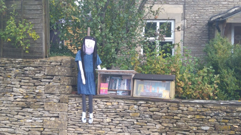 photo of Matilda scarecrow with Little Free Library