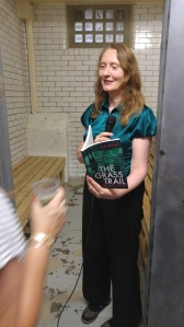 photo of AA Abbott reading her book in cell