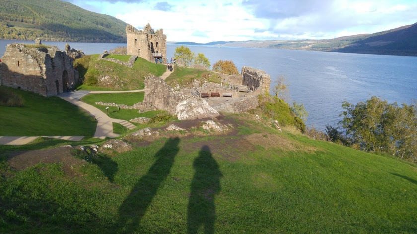 Photo of tall shadow of Debie cast over castle by Loch Ness