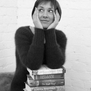 image of Jane Davis with pile of books