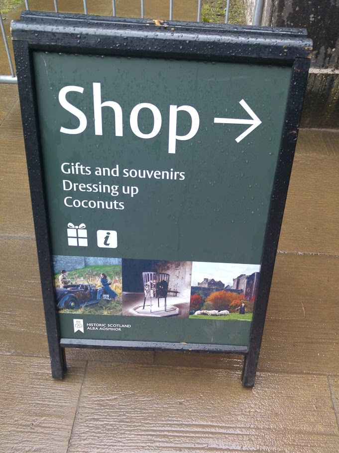 photo of sign for shop showing availability of coconut shells