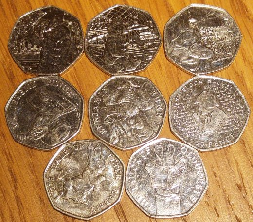 array of Beatrix Potter, Paddington Bear and Sherlock Holmes 50p coins
