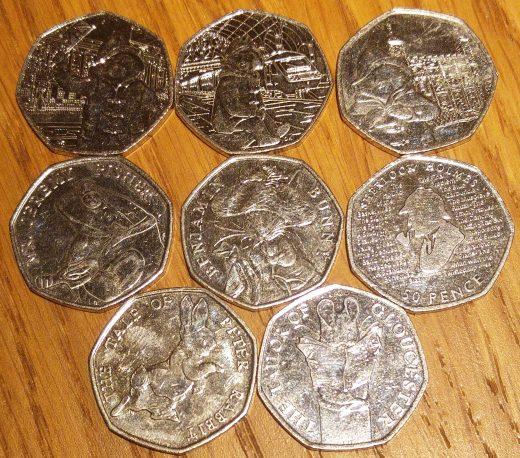 array of Beatrix Potter, Paddington Bear and Sherlock Holmes 50p coins