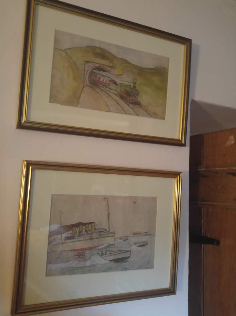 photo of two framed painting in situ on the wall